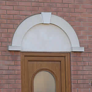 curved door header with keystone